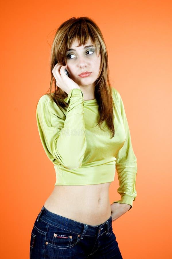 телефон девушки стоковые фото