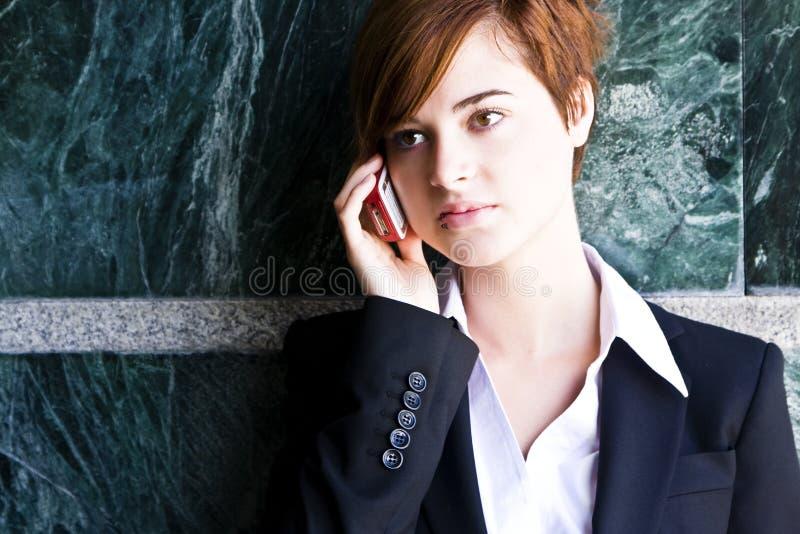 телефон коммерсантки стоковые фото