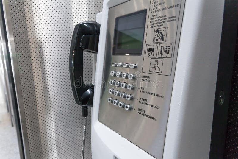 Телефон наземной линии в аэропорте, конце вверх стоковая фотография rf
