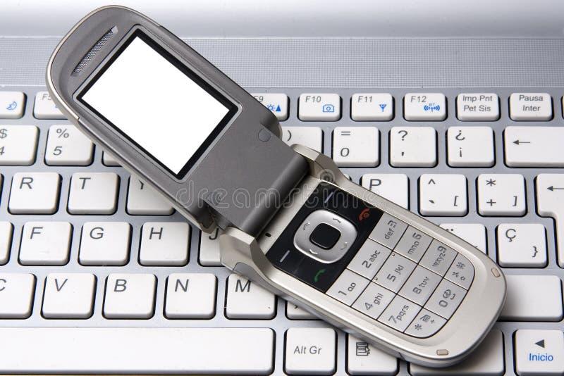 телефон тетради клетки стоковые фото