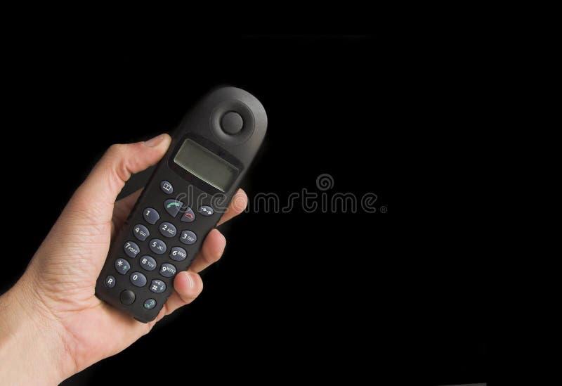 Download телефон удерживания руки стоковое изображение. изображение насчитывающей связывайте - 476051