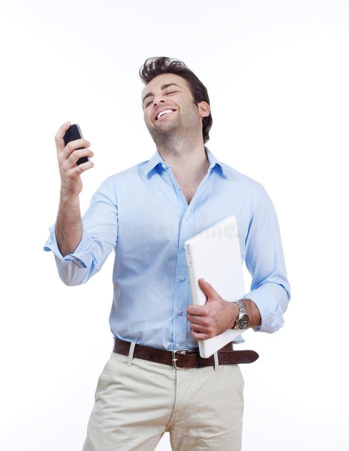 телефон человека компьтер-книжки клетки стоковое фото rf
