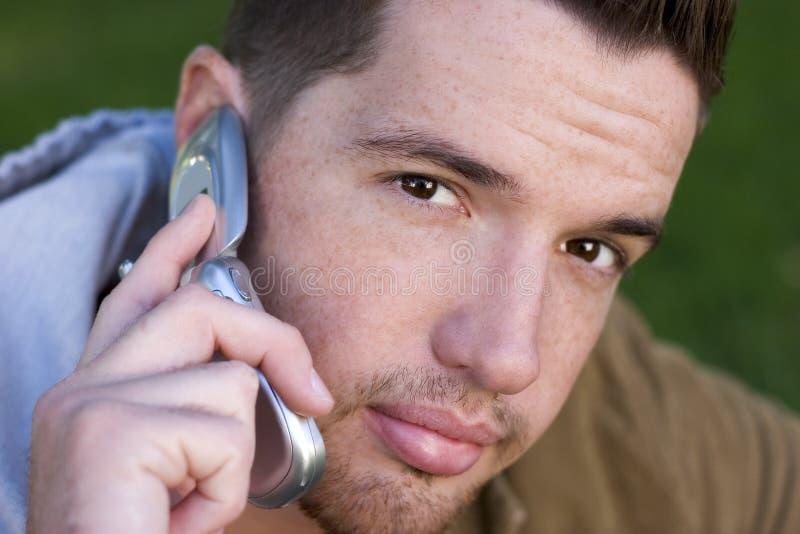 телефон человека стоковое фото