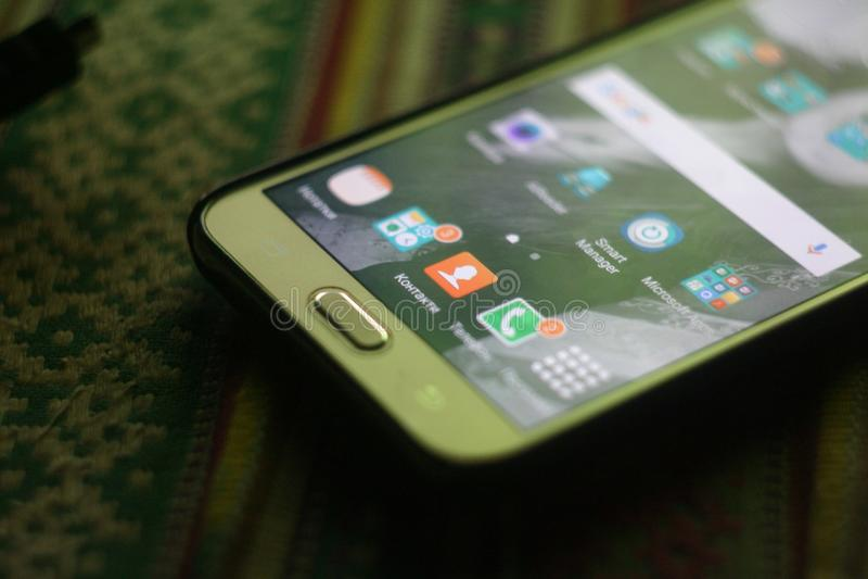 Телефон J700 стоковые фото