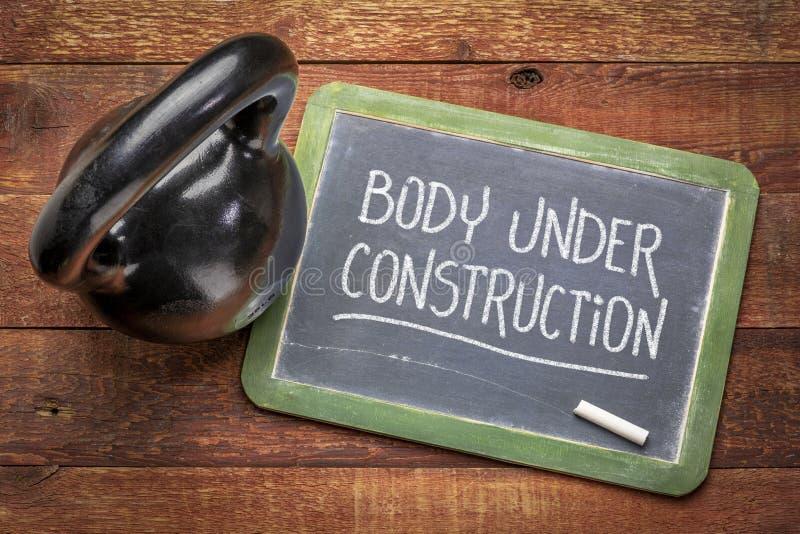 Тело строится - фитнес-концепция стоковое изображение rf