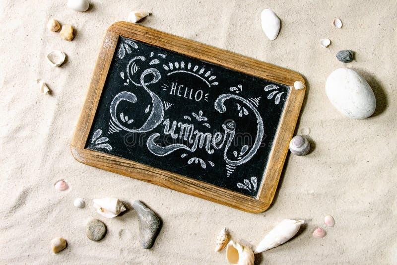 Тема лета на песке стоковые фото