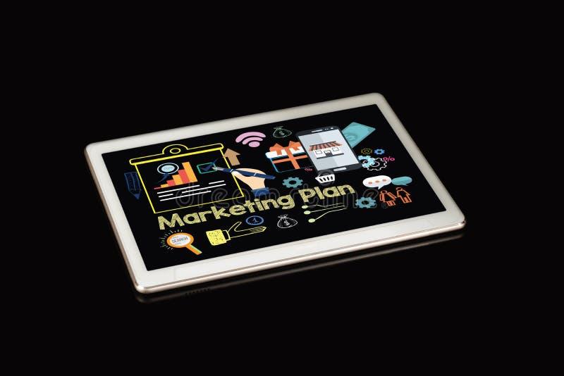 Тема маркетингового плана с экраном планшета на черной предпосылке стоковое изображение