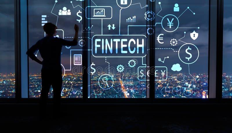 Тема Fintech с человеком большими окнами на ноче стоковое изображение rf