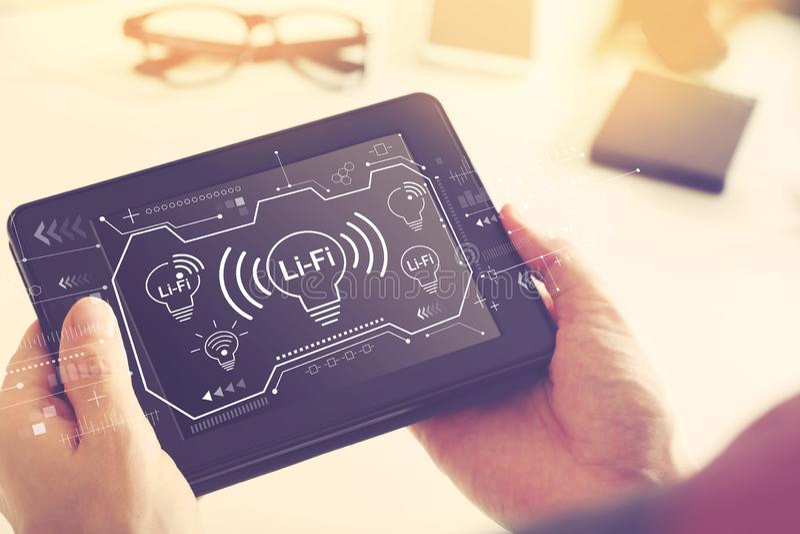 Тема LiFi с планшетом стоковые фотографии rf