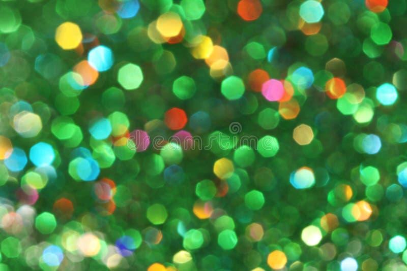 Темная абстрактная зеленая, красный, желтый, предпосылка рождества предпосылки яркого блеска бирюзы дерев-абстрактная стоковое изображение