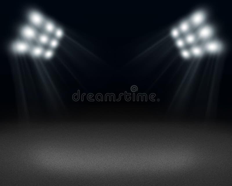 Темная комната с пятном света на поле и стоковые изображения rf