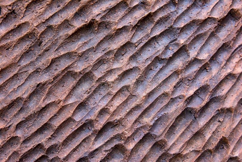Темная предпосылка плитки глины стоковые фото