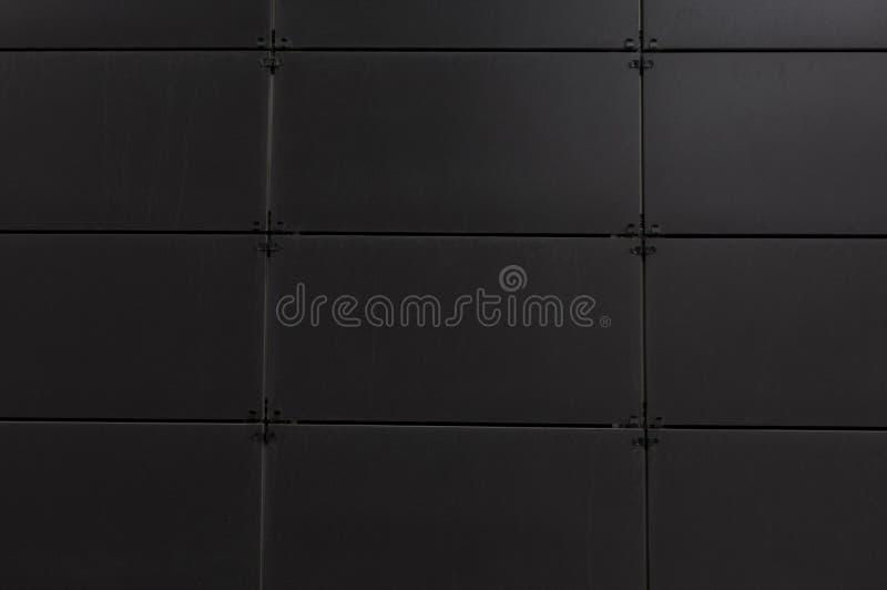 Темная стена предпосылки с нашивками стоковое изображение