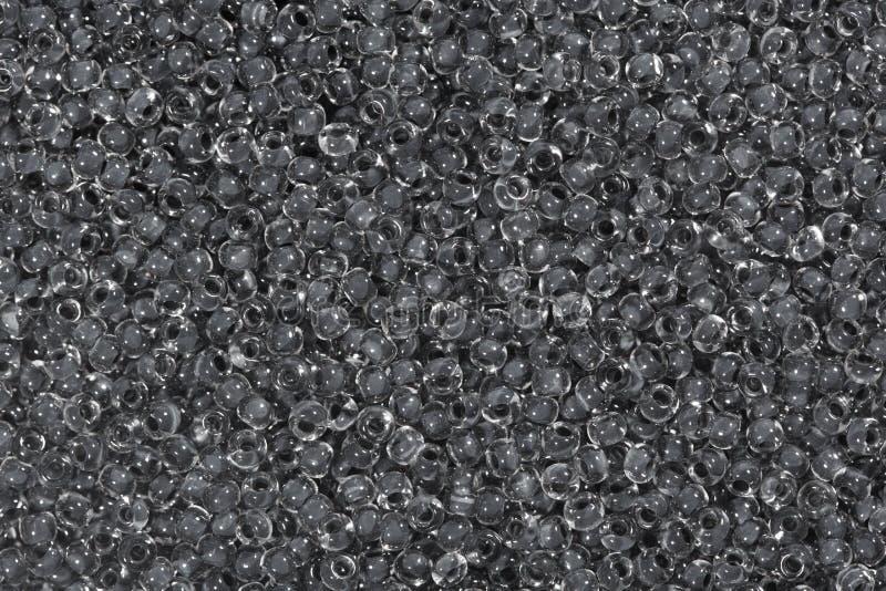 Темное серое стеклянное семя отбортовывает предпосылку стоковое изображение
