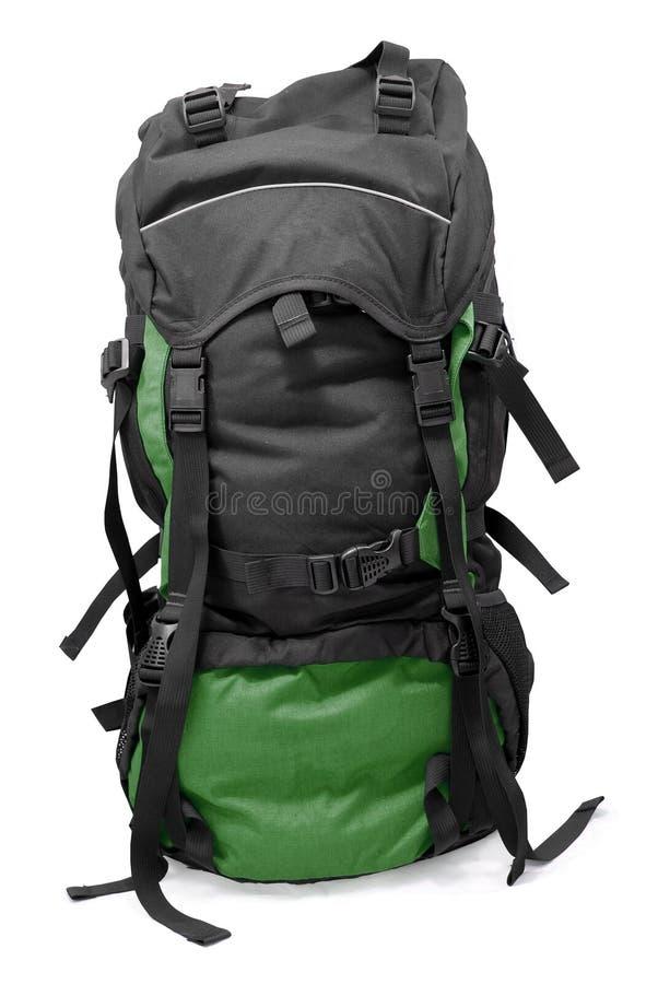 темнота backpack - зеленый турист стоковое фото rf