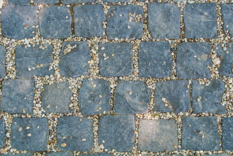 Темный - серая текстура мостоваой камня гранита, абстрактный булыжник p стоковая фотография rf