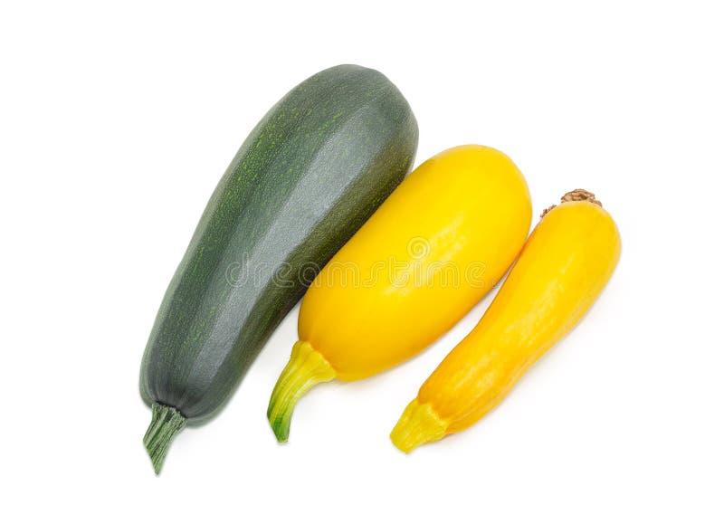 Темный ый-зелен цукини и желтые vegetable сердцевины стоковые изображения