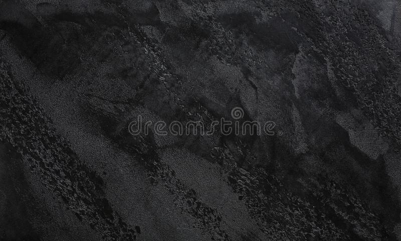 Темным серым или черным предпосылка текстурированная шифером стоковое фото rf