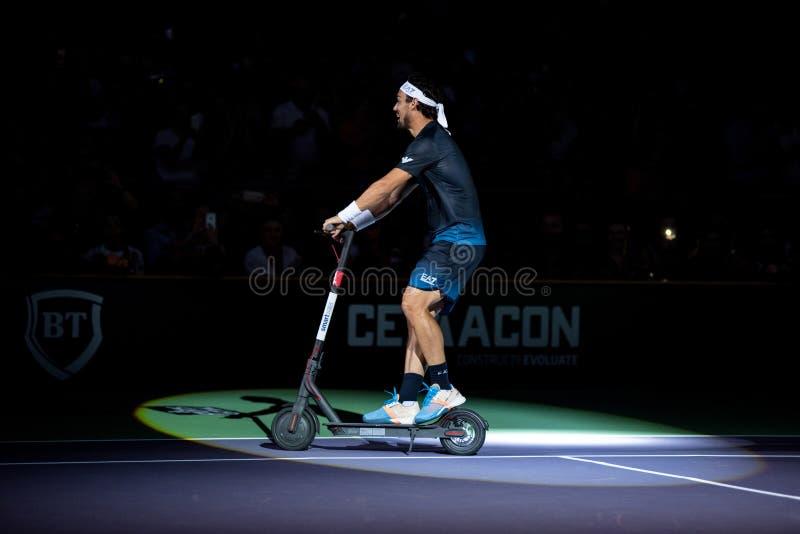 Теннисист Fabio Fognini на электрическом скутере стоковое изображение