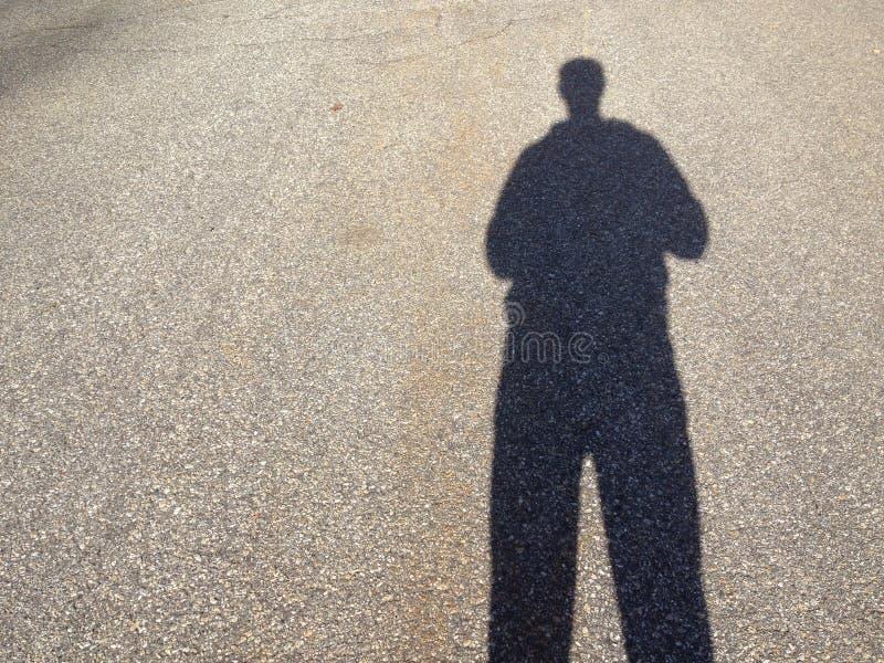 Тень на дороге стоковые фото
