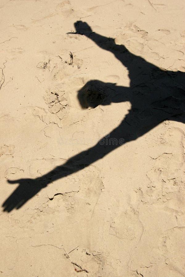 тень песка человека s стоковое фото rf