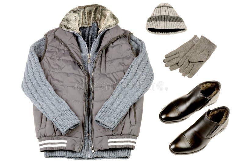 Теплая одежда ` s людей зимы на белой предпосылке стоковое изображение