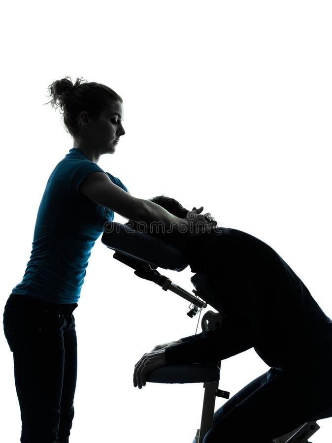 Терапия массажа с силуэтом стула стоковая фотография