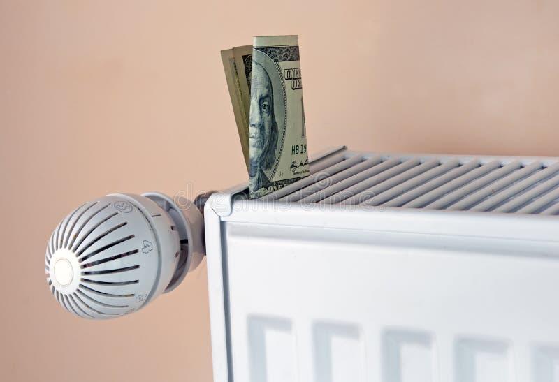 Термостат с деньгами стоковое фото
