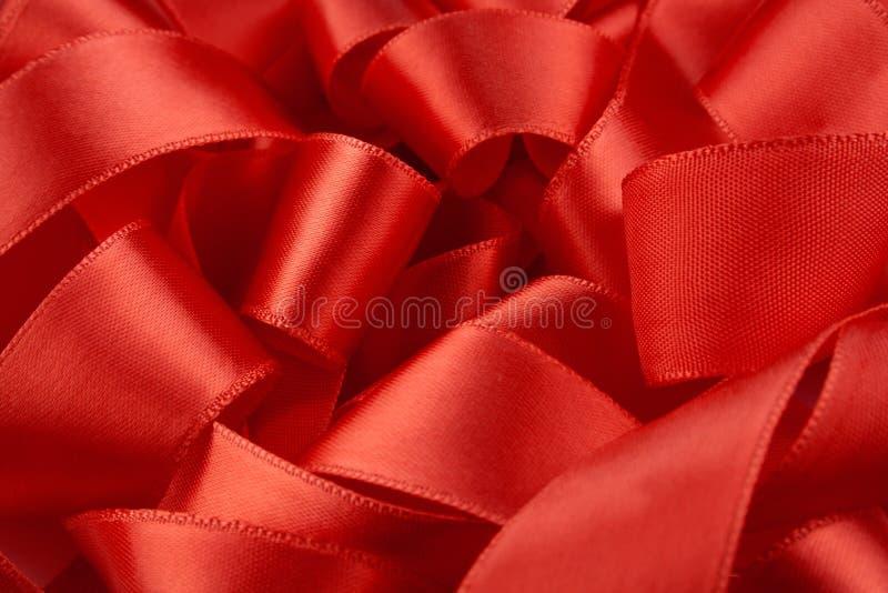 тесемка красного цвета макроса стоковое фото