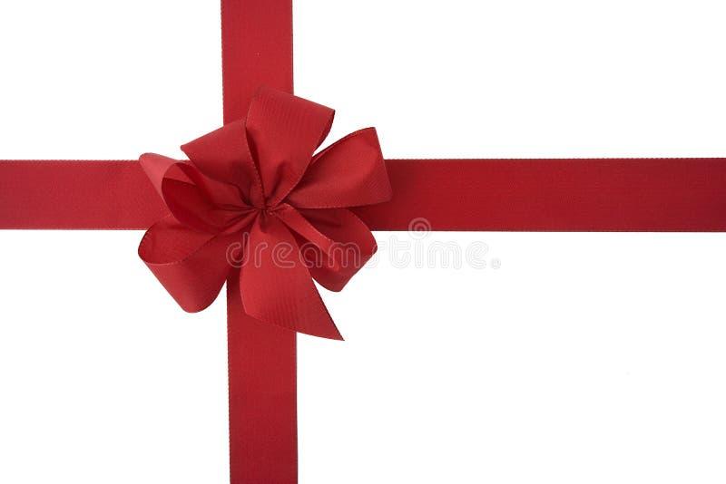 тесемка красного цвета подарка смычка стоковое фото rf