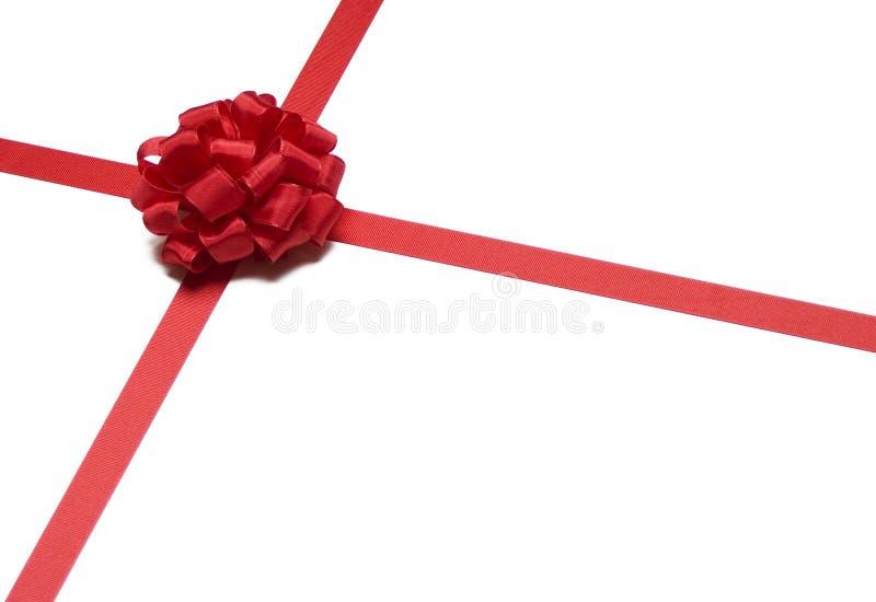 тесемка красного цвета рождества смычка стоковая фотография rf