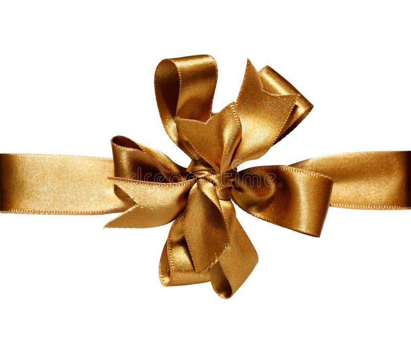 тесемка смычка золотистая стоковое изображение