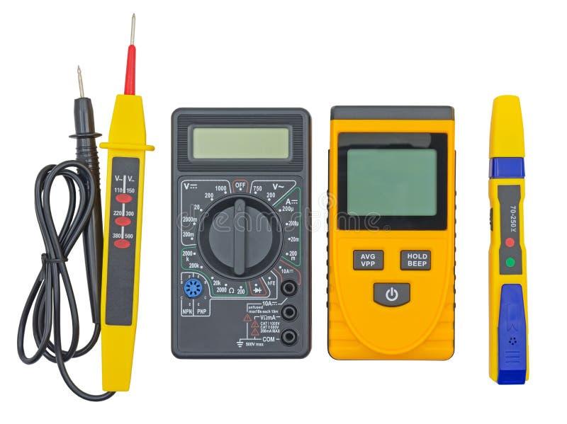 Тестер напряжения тока и другие приборы на белизне стоковые изображения rf
