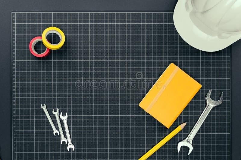 Тетрадь и инструменты на миллиметровке стоковое фото rf