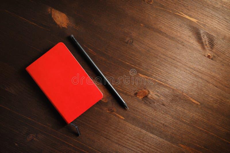 Тетрадь и карандаш стоковые фотографии rf