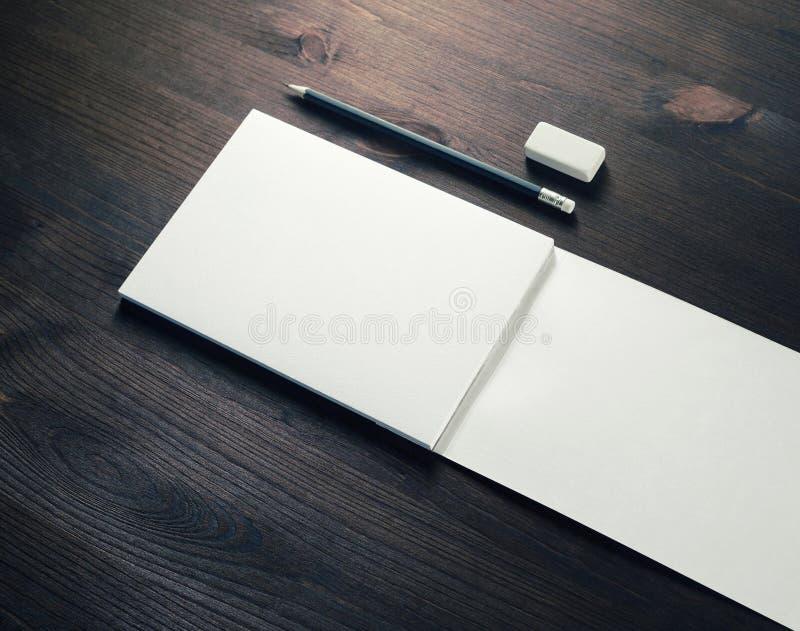 Тетрадь, карандаш и ластик стоковое изображение