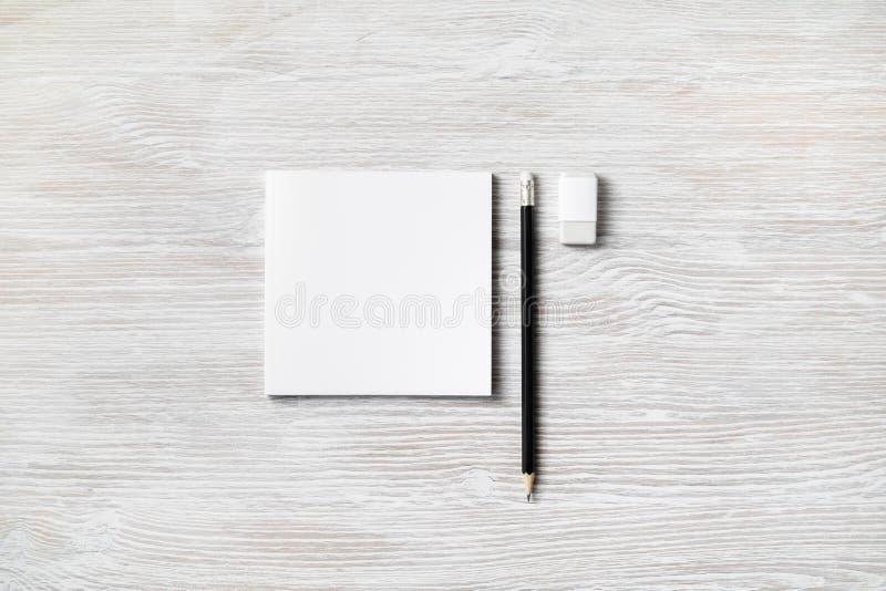 Тетрадь, карандаш, ластик стоковые изображения rf