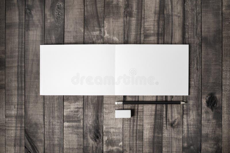 Тетрадь, карандаш, ластик стоковые изображения