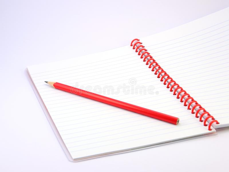 Тетрадь и карандаш стоковое изображение rf