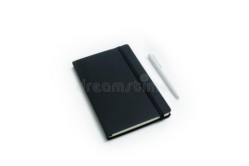 Тетрадь и ручка белизны стоковое изображение
