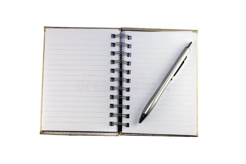 Тетрадь и ручка стоковые изображения