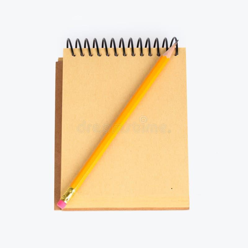 Тетрадь с карандашем стоковые фотографии rf