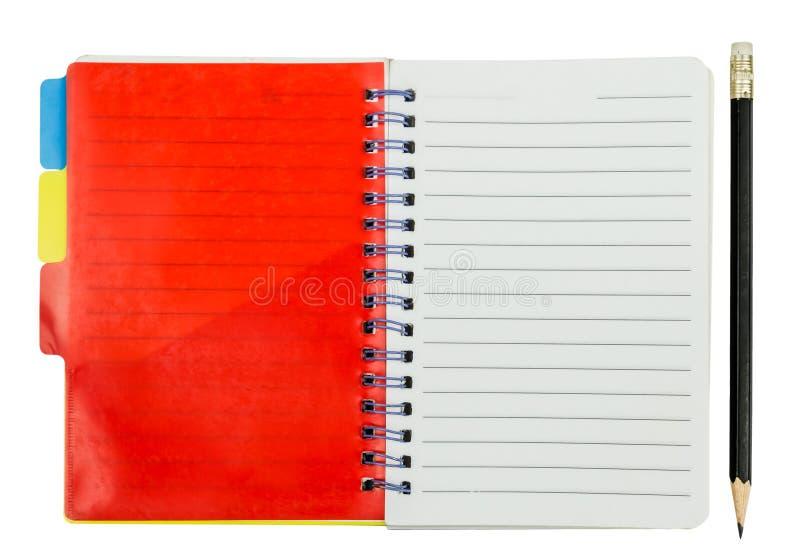 Тетрадь с красными закладкой и карандашем стоковая фотография rf