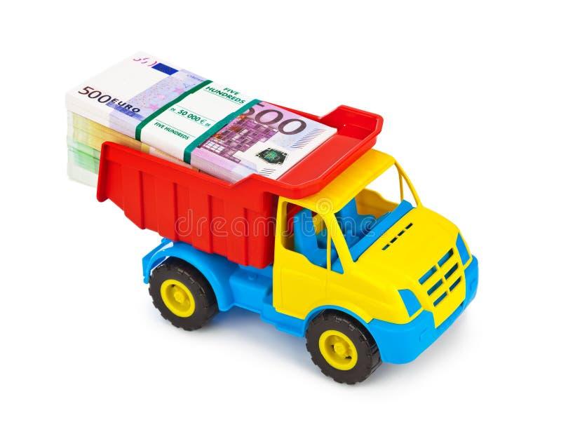 Тележка игрушки с деньгами стоковые фотографии rf