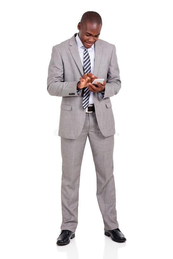 Телефон бизнесмена умный стоковое фото