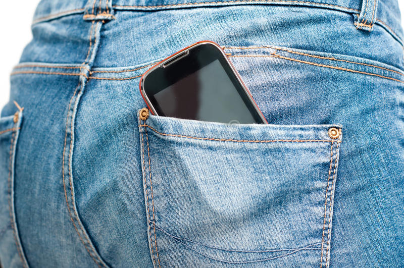 Телефон в заднем карманн стоковые изображения rf