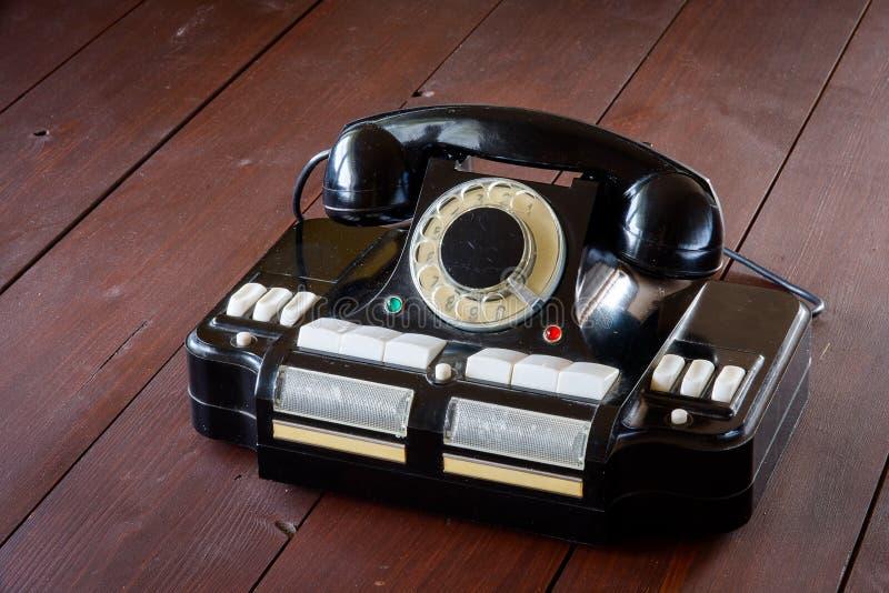Телефон-к-эпицентр деятельности CD-6 ` s директора стоковое изображение