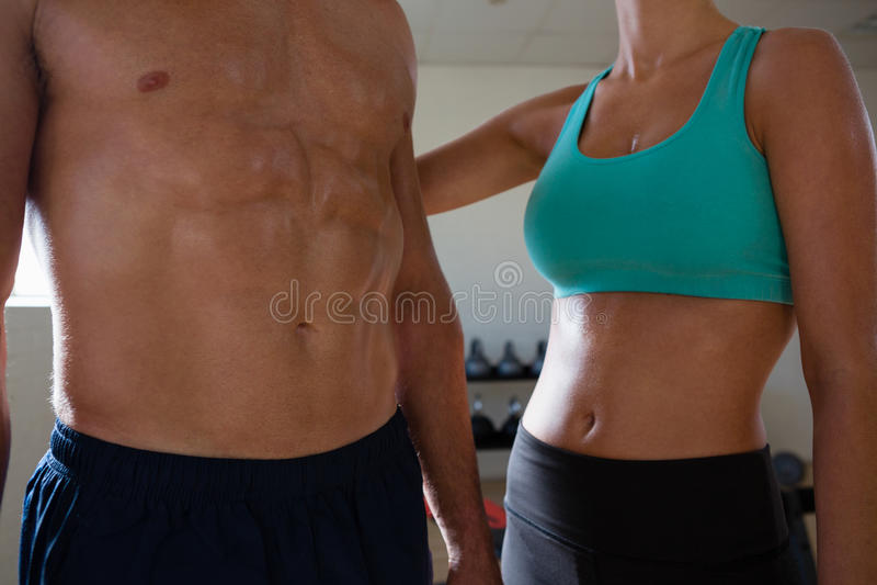 Тело спортсменов мышечное стоковое фото rf
