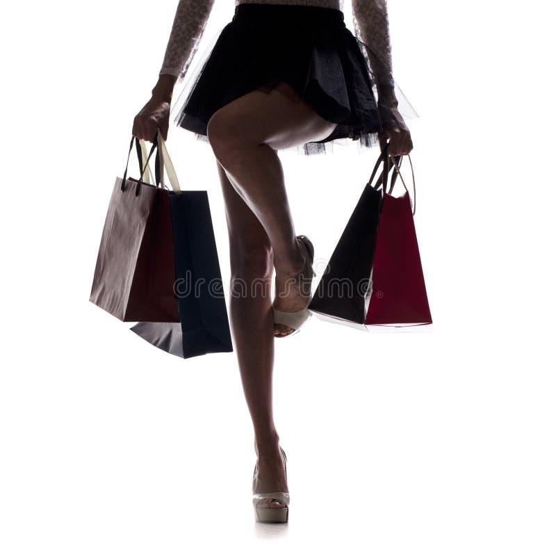 Тело части, красивые женские худенькие ноги Сексуальная девушка держа PA стоковые изображения