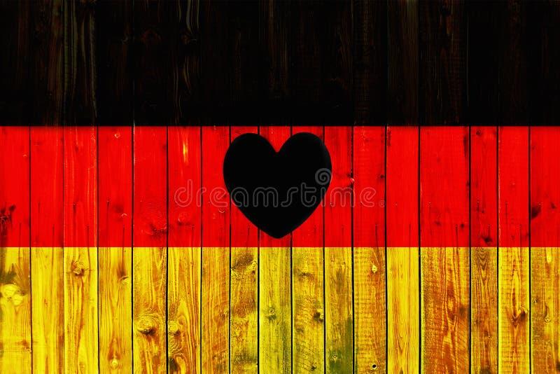 Ткани предпосылки страны символа флага Германии сердце загородки Европы национальной патриотической немецкое деревянное стоковые фото